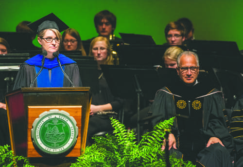 Rebecca Weaver-Hightower, a professor in English at UND, presides over the inauguration of President Mark Kennedy on Monday, October 10, 2016 at the Chester Fritz Auditorium.