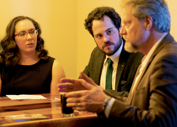UND english lecturer David Haeselin (center), who edited the recent anthology work 'Haunted By Waters,' listens to UND social work professor Bret Weber (right) during a discussion of the work at Rhombus Guys Brewery on Thursday, April 20, 2017.