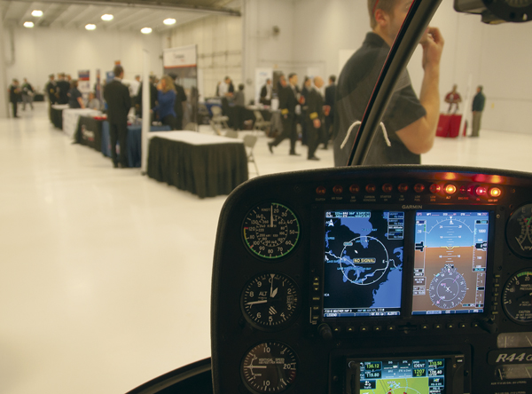 The cockpit of a Robinson R-44 helicopter was one of many simulations on display for a Student Aviation Management Association (SAMA) event Saturday, April 22, 2017 at the Grand Forks Air Force Base.