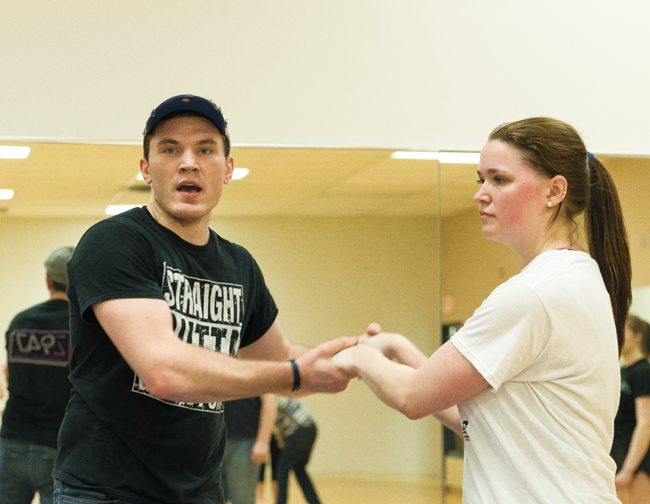 Tyler+Bye-Jehns+demonstrates+a+dance+move+with+Emily+Makaruk+during+a+swing+dance+class+on+Thursday%2C+March+30%2C+2017.