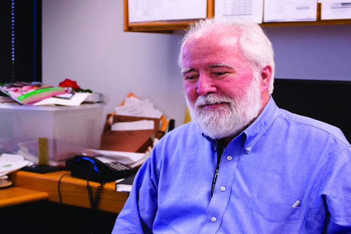 Professor writes trilogy, 40 year process