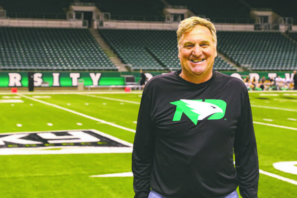 Bubba Schweigert, the head coach for the UND football team, stands at the Alerus Center on Thursday, September 15, 2016. Photo by Alley Stroh/ The Dakota Student