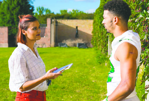 Dakota Student sports editor Allyson Bento interviews UND football running back John Santiago after a football practice on September 13, 2016.