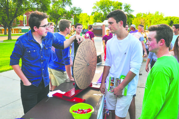 Geography club president Elijah Sack speaks to students during the Student Involvement Expo on Saturday, August 20, 2016.