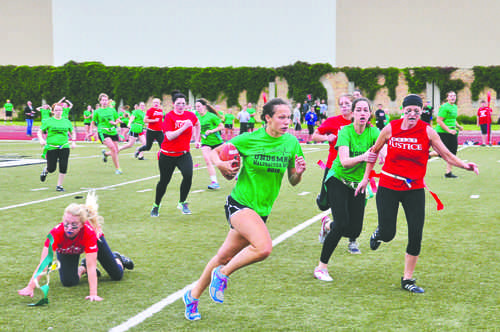 Women from the medical and law schools competed Friday at Memorial Stadium prior to the men. Photo by Daniel Yun/ The Dakota Student