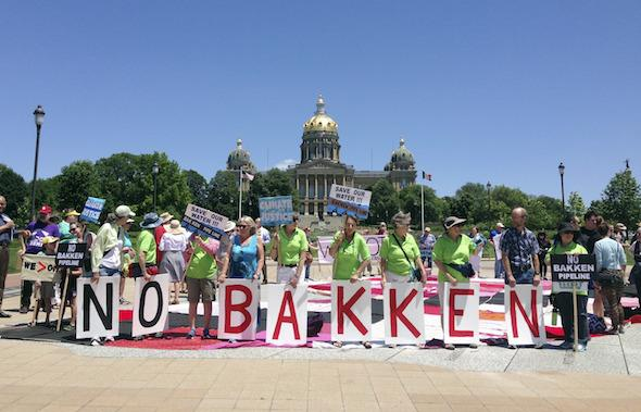 Organizations opposing the Dakota Access pipeline project, also known as the Bakken pipeline which stretches from North Dakota across South Dakota and Iowa into Illinois, rally at the Iowa Capitol in Des Moines, Monday, June 6, 2016. AP Photo/ Barbara Rodriguez