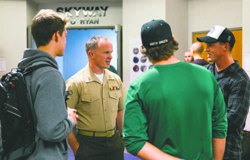 United States Marine Corps Captain Chris Cory (center) speaks with UND students (from left) Henry Berning, Daniel Lockhert and Nicholas Libert during an informational meeting at Clifford Hall on Monday, September 12, 2016. Photo by Nick Nelson/ The Dakota Student