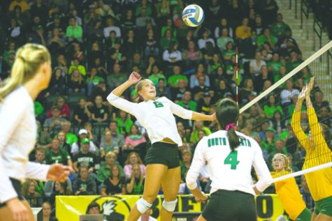 UND middle-hitter Faith Dooley prepares to spike back to NDSU during a game last season.