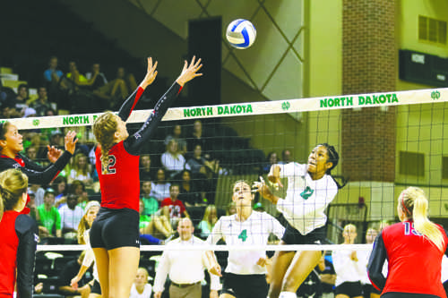 Middle hitter Jordan Vail spikes the ball against Texas Tech's Katy Keenan on Friday, September 3, 2016 at the Betty. The Fighting Hawks lost 3-0 against the Lady Raiders. Photo by Nick Nelson/ The Dakota Student