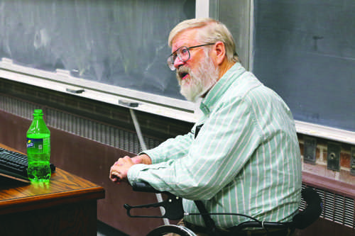 Michael Gaffey, a UND professor Space Studies, speaks during an astronomy event Monday evening at Witmer Hall.