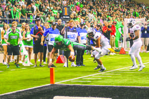 Keaton Studsrud dives towards the touchdown line during Saturday's Homecoming game against Southern Utah.