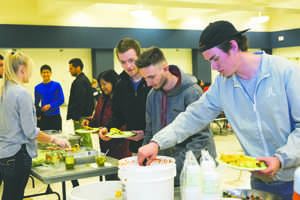 UND students line up for tacos during a hispanic heritage event at the Memorial Union ballroom on Wednesday.