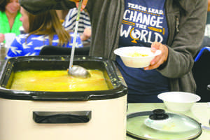 A UND student ladles up soup during a Soup Friday luncheon at the American Indian Student Services Center (AISS) on Friday.