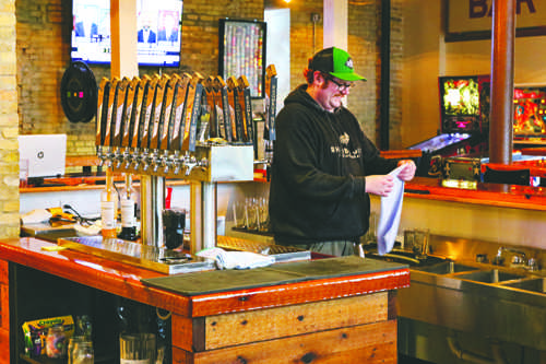 Steve Cowger cleans the bar at Rhombus Guys Brewing Company in downtown Grand Forks on Tuesday, October 4, 2016