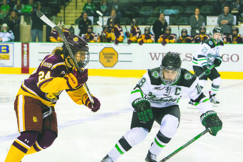 Halli Krzyzaniak intercepts University of Minnesota Duluth forward Michela Cava during a game at the Betty Engelstad Sioux Center last season.
