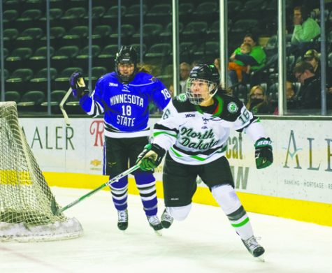 Vilma Tanskanen chases the puck during Saturday's game against Minnesota State Mankato at the Ralph Engelstad Arena.