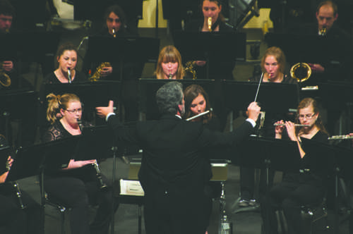 Dr. James Popejoy directs the UND Wind Band Ensemble during a concert Tuesday evening at the Chester Fritz Auditorium.