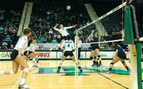Faith Dooley (center) jumps for the spike against Idaho Saturday evening at the Betty Engelstad Sioux Center.