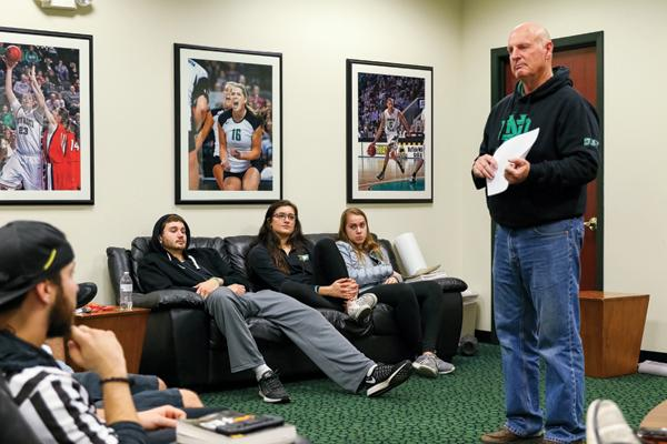 UND student athletes (on sofa) Conner Avants, Fallyn Freije and Bailey Strand listen as Ev Nelson (right) leads a Fellowship of Christian Athletes (FCA) meeting Monday evening at the Betty Engelstad Sioux Center.