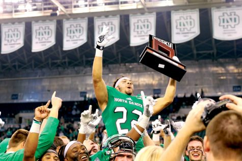 Running back John Santiago celebrates UND's Big Sky conference championship after defeating Northern Arizona University last Saturday at the Alerus Center.
