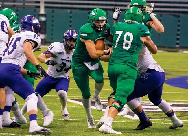 Senior quarterback Ryan Bartels finds an opening in the Weber State defense Oct. 29 at the Alerus Center.