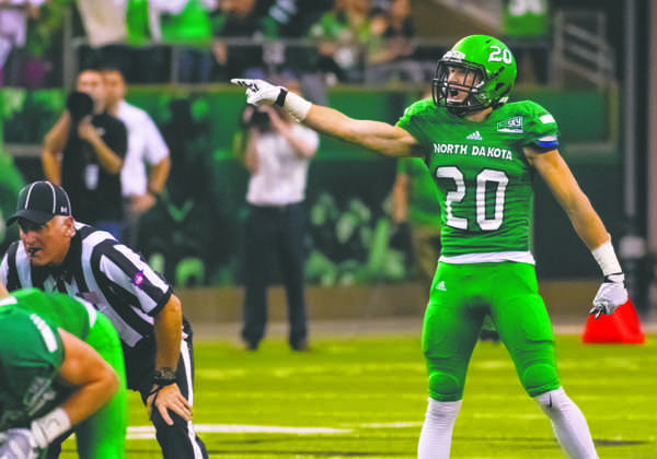 Zach Arnell yells for his teammates during the fourth quarter of Saturday's game against Weber State at the Alerus Center.
