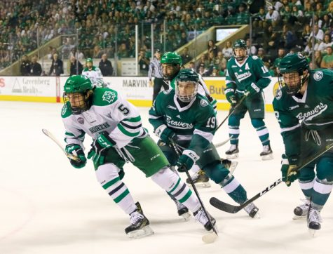 Freshman defender Casey Johnson chases the puck against Bemidji State at the Ralph Engelstad Arena on Saturday, Oct. 22.