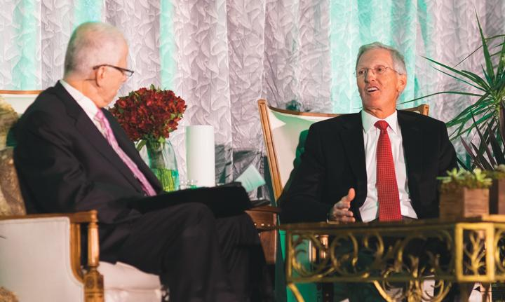 UND alumnus and former Cargill CEO Greg Page speaks with provost Thomas DiLorenzo during Thursday's Olaf Ethis Symposium at the Memorial Union Ballroom.