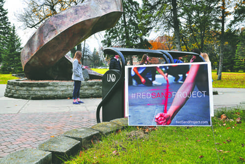 The Red Sand Project, taking place Friday in front of the 'Persistence' statue on campus, aims to raise awareness about human trafficking and other forms of exploitation.