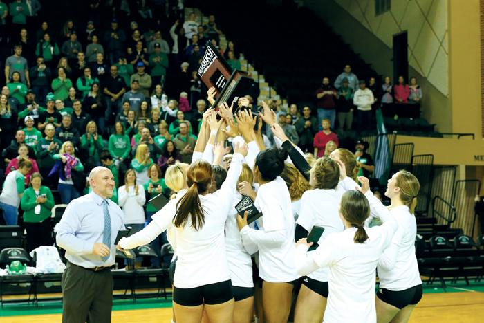 The+UND+Volleyball+team+celebrates+their+first-ever+Big+Sky+conference+championship+win+Saturday+evening+at+the+Betty+Engelstad+Sioux+Center.