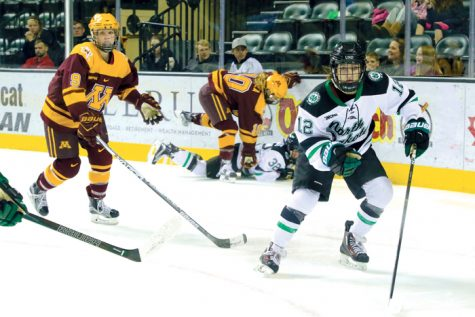 Ryleigh Houston chases the puck against the University of Minnesota Golden Gophers Saturday at the Ralph Engelstad Arena.