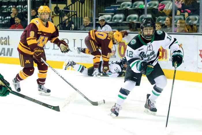 Ryleigh+Houston+chases+the+puck+against+the+University+of+Minnesota+Golden+Gophers+Saturday+at+the+Ralph+Engelstad+Arena.