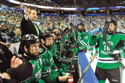 UND coach Brad Berry gives directions to men's hockey players during the Frozen Four tournament at Amalie Arena in Tampa, FL on April 9, 2016. (Russ Hons/Russell Hons Photography)