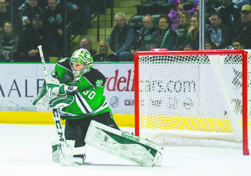 UND goalie Matt Hrynkiw blocks a shot against Colorado College last season. Nick Nelson/ Dakota Student