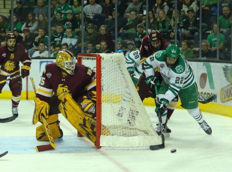 Rhett Gardner rounds UMD goal Saturday night at the Ralph Engelstad Arena. Daniel Yun/ Dakota Student