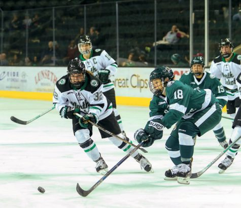 Hallie Theodosopoulos chases the puck as Bemidji State's Lisa Laiti attempts to block her earlier this season at the Ralph Engelstad Arena.