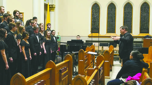 Members of the UND Concert Choir perform Saturday at St. Mary's church. Jacob Notermann/ Dakota Student