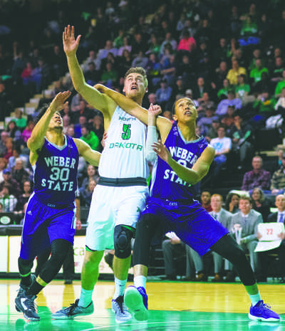 UND junior center Carson Shanks tussles with Weber State's Jeremy Senglin (left) and Jordan Dallas (right) during a game in January at the Betty Engelstad Sioux Center. Nick Nelson/ Dakota Student