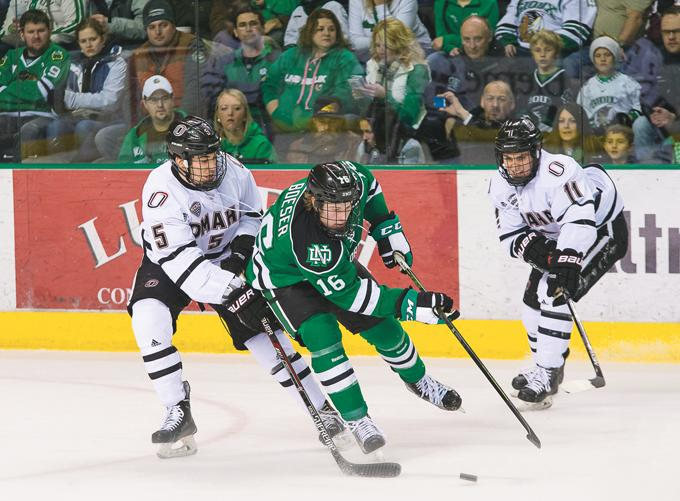 UND men's hockey forward Brock Boeser evades Omaha's Joel Messner (left) and Mason Morelli (right) during a game last season at the Ralph Engelstad Arena. (Nick Nelson/Dakota Student)