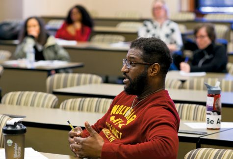 Lee Edward Brockington (front) speaks during the (de)constructing race discussion held last Friday at the School of Law.