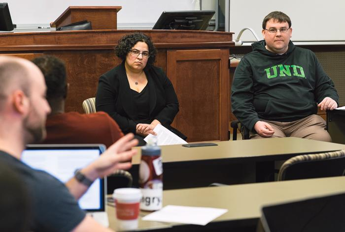 Assistant+law+professors+Sabrina+Balgamwalla+%28center%29+and+Grant+Christensen+%28right%29+listen+to+a+law+student+during+a+discussion+on+race+and+law+last+Friday.