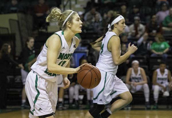 Sophomore guard Grace Sawatzke (left) looks for open players as Fallyn Freije (right) sprints down the court in a game last month at the Betty Engelstad Sioux Center. Nick Nelson/ Dakota Student