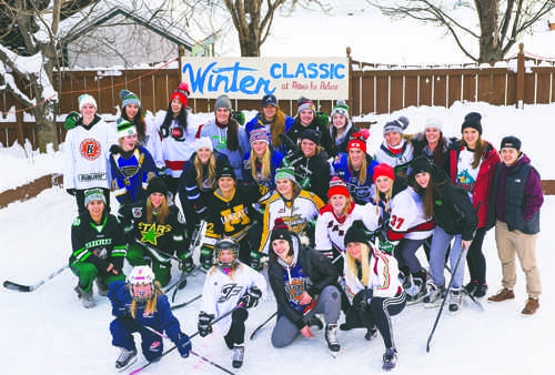 Members of the UND women's hockey team pose for a team photo after competing in the annual Peter's Winter Classic event on Jan. 16, 2017. Nick Nelson/ Dakota Student
