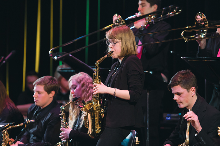 Marcie Woehl performs a solo during the UND Jazz Ensemble conceert Monday night.