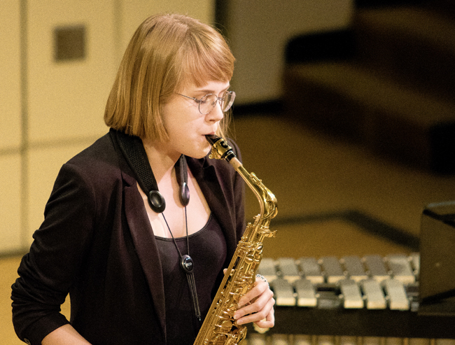 Marcie Woehl plays saxophone Tuesday night during the UND Jazz Combo concert at Hughes Fine Arts Center.