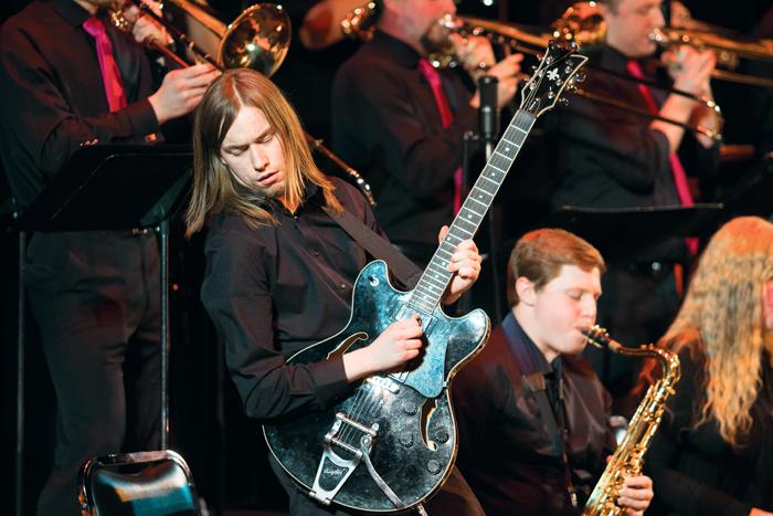 Wyatt Tuner belts out a guitar solo during Mondays UND Jazz Ensemble concert.