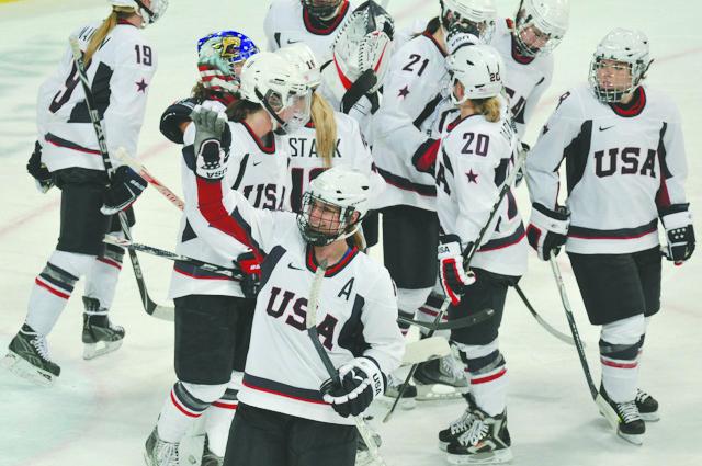 The+2010+U.S.+Women%27s+Hockey+team+celebrating+a+win