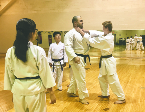 Students spar at Hisshou Karate in the Hyslop Sports Center.