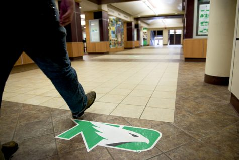 A UND student walks across the main level of the Memorial Union on March 27, 2017. DS File Photo