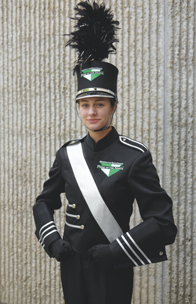 Flutist Alexis Schwinghamer models the new UND Pride of the North Marching Band uniform complete with new gauntlets, logo and shako (helmet).